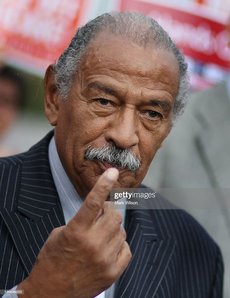 U.S. Rep. <a gi-track='captionPersonalityLinkClicked' href=/galleries/search?phrase=John+Conyers&family=editorial&specificpeople=217823 ng-click='$event.stopPropagation()'>John Conyers</a> (D-MI) participates in a news conference at the U.S. Capitol October 26, 2011 in Washington, DC. Conyers called on the Joint Deficit Reduction Committee to preserve Medicare, Medicaid, and Social Security benefits when making their decision on cutting the deficit.