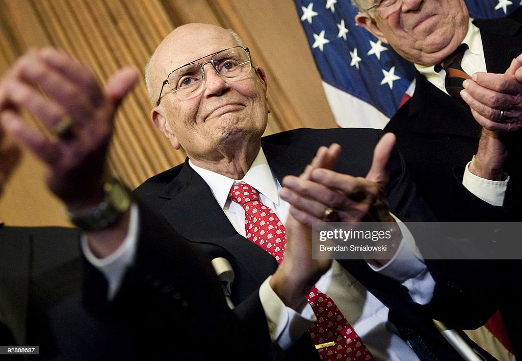 Rep. John Dingell (D-MI) claps during a press conference after a vote on healthcare on Capitol Hill November 7, 2009 in Washington, DC. The House of Representatives passed the healthcare reform bill 220 to 215 after a late night vote.