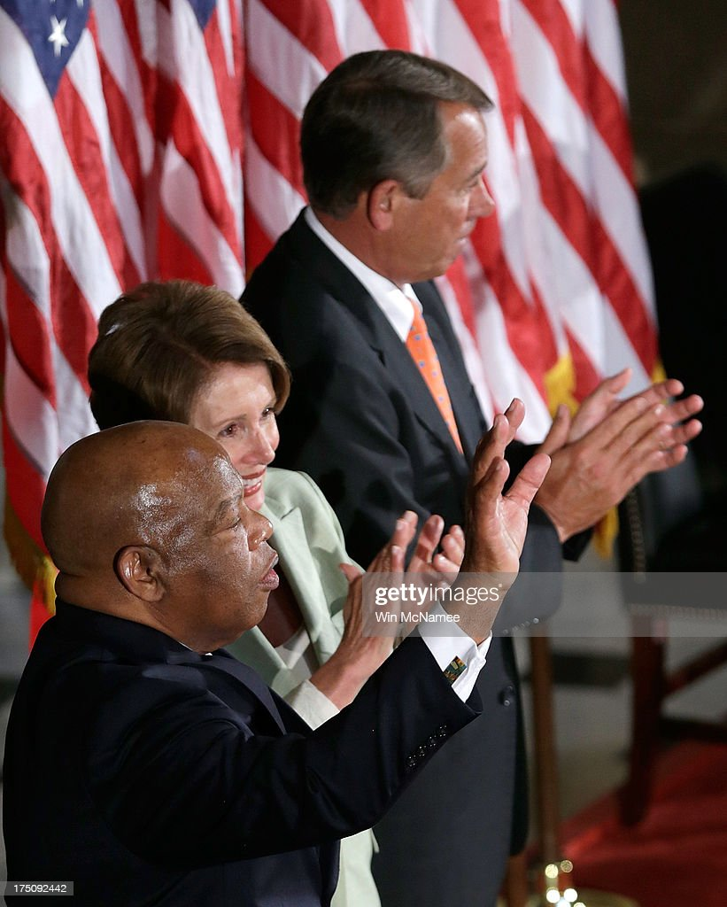 U.S. Rep. John Lewis (D-GA) (L) acknowledges applause from the audience, and House Minority Leader <a gi-track='captionPersonalityLinkClicked' href=/galleries/search?phrase=Nancy+Pelosi&family=editorial&specificpeople=169883 ng-click='$event.stopPropagation()'>Nancy Pelosi</a> (D-CA) (C) and Speaker of the House <a gi-track='captionPersonalityLinkClicked' href=/galleries/search?phrase=John+Boehner&family=editorial&specificpeople=274752 ng-click='$event.stopPropagation()'>John Boehner</a> (R-OH) (R), after speaking in Statuary Hall of the U.S. Capitol for a ceremony honoring the 50th anniversary of the March on Washington July 31, 2013 in Washington, DC. Lewis was a speaker on the day of the historic civil rights movement's March on Washington in 1963.