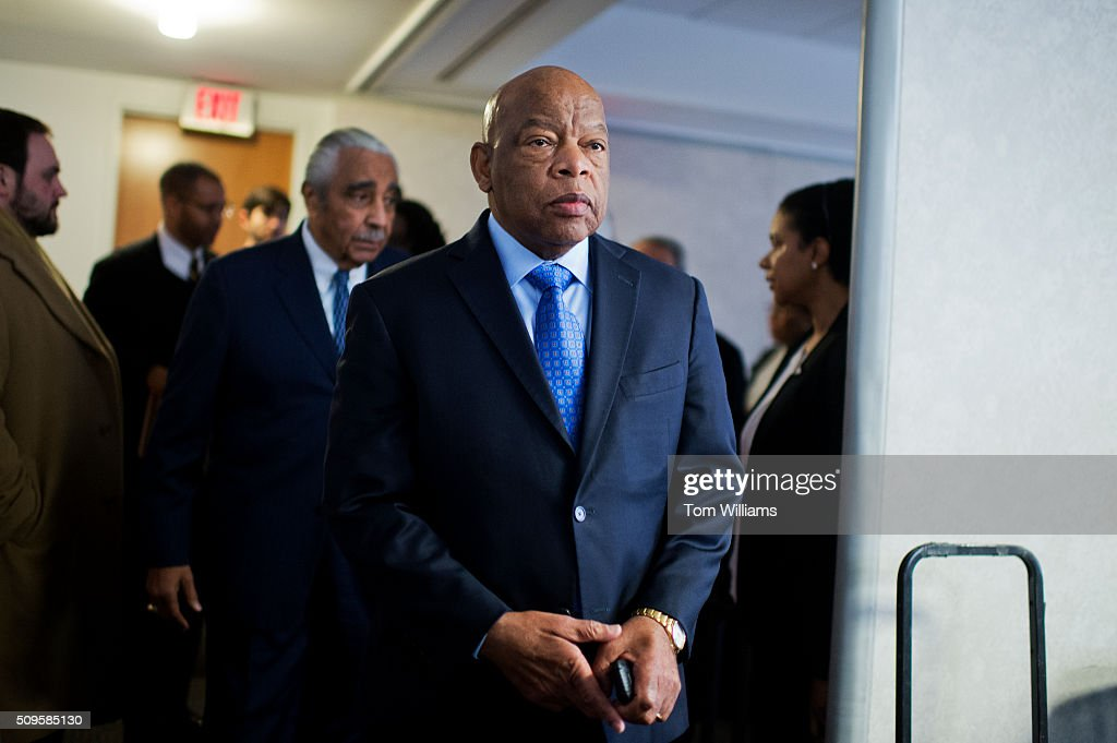 Rep. John Lewis, D-Ga., and Rep. Charlie Rangel, D-N.Y., behind him, arrive for a news conference at the DNC where members of the Congressional Black Caucus PAC endorsed Hillary Clinton for president, February 11, 2016.