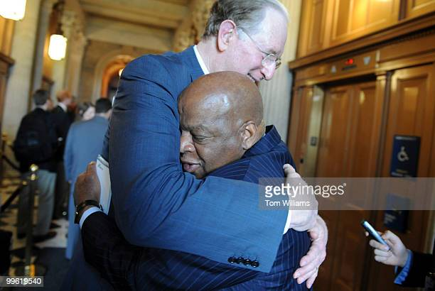 Rep John Lewis DGa right gets a hug from Sen John Rockefeller DWV after a meeting with democratic senators at which Lewis discussed the history of...
