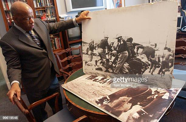 Rep John Lewis DGa shows pictures of police attacking himself and other marchers on Bloody Sunday in Selma Alabama