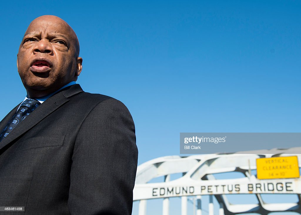 Rep John Lewis DGa stands on the Edmund Pettus Bridge in Selma Ala in between television interviews on Feb 14 2015 Rep Lewis was beaten by police on...