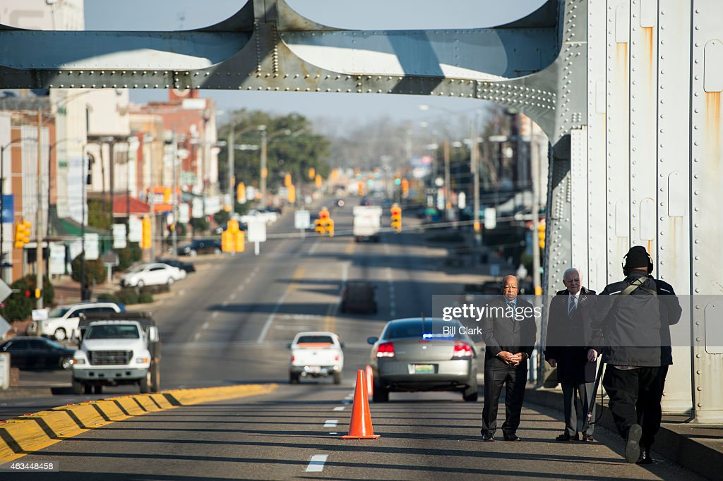 Rep. John Lewis, D-Ga., walks across the Edmund Pettus Bridge with <a gi-track='captionPersonalityLinkClicked' href=/galleries/search?phrase=Bob+Schieffer&family=editorial&specificpeople=2129374 ng-click='$event.stopPropagation()'>Bob Schieffer</a> of CBS News on Saturday, Feb. 14, 2015. Rep. Lewis was beaten by police on the bridge on 'Bloody Sunday' 50 years ago on March 7, 1965, during an attempted march for voting rights from Selma to Montgomery.