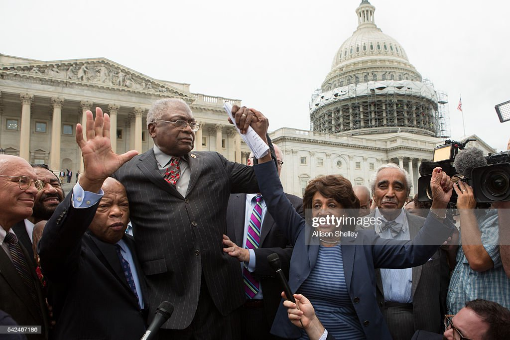 Rep. John Lewis (D-GA), (3rd L), <a gi-track='captionPersonalityLinkClicked' href=/galleries/search?phrase=James+Clyburn&family=editorial&specificpeople=668762 ng-click='$event.stopPropagation()'>James Clyburn</a> (D-SC), <a gi-track='captionPersonalityLinkClicked' href=/galleries/search?phrase=Maxine+Waters&family=editorial&specificpeople=220525 ng-click='$event.stopPropagation()'>Maxine Waters</a> (D-CA) and <a gi-track='captionPersonalityLinkClicked' href=/galleries/search?phrase=Charles+Rangel&family=editorial&specificpeople=213581 ng-click='$event.stopPropagation()'>Charles Rangel</a>, (D-NY), right, speak with supporters outside the U.S. Capitol building June 23, 2016 in Washington, DC. Democratic House members ended their overnight House floor sit-in trying to force a vote on gun control legislation.