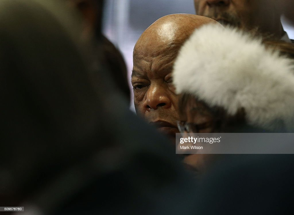 Rep. John Lewis (D-GA) (C), listens as members of the Congressional Black Caucus endorce Hillary Clinton during a news conference at the DNC headquarters on Capitol Hill, February 11, 2016 in Washington, DC. The CBC announced that the are endorsing former Secretary of State, Hillary Clinton, for the Democratic nomination for President