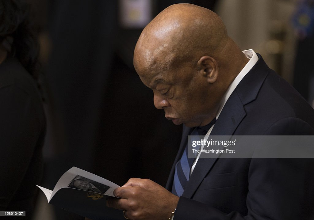 S. Rep. John Lewis (D-GA) reads the program for Senator Daniel Inouye (D-HI) during a ceremony at the Capitol Rotunda on Capitol Hill in Washington, D.C., on Thursday, December 20, 2012. Inouye, President Pro Tempore of the United States Senate will lie in state until Friday before a funeral service at the Washington National Cathedral.