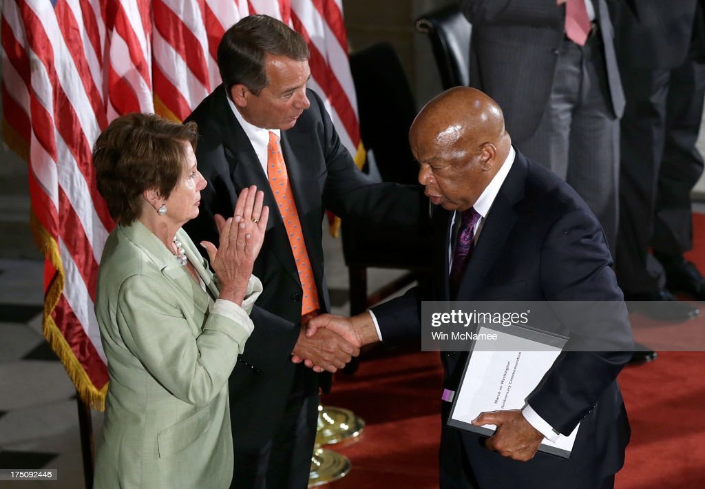 U.S. Rep. John Lewis (D-GA) (R) shakes hands with Speaker of the House <a gi-track='captionPersonalityLinkClicked' href=/galleries/search?phrase=John+Boehner&family=editorial&specificpeople=274752 ng-click='$event.stopPropagation()'>John Boehner</a> (R-OH) (C) and House Minority Leader <a gi-track='captionPersonalityLinkClicked' href=/galleries/search?phrase=Nancy+Pelosi&family=editorial&specificpeople=169883 ng-click='$event.stopPropagation()'>Nancy Pelosi</a> (D-CA) (L) in Statuary Hall of the U.S. Capitol during a ceremony honoring the 50th anniversary of the March on Washington July 31, 2013 in Washington, DC. Lewis was a speaker on the day of the historic civil rights movement's March on Washington in 1963.