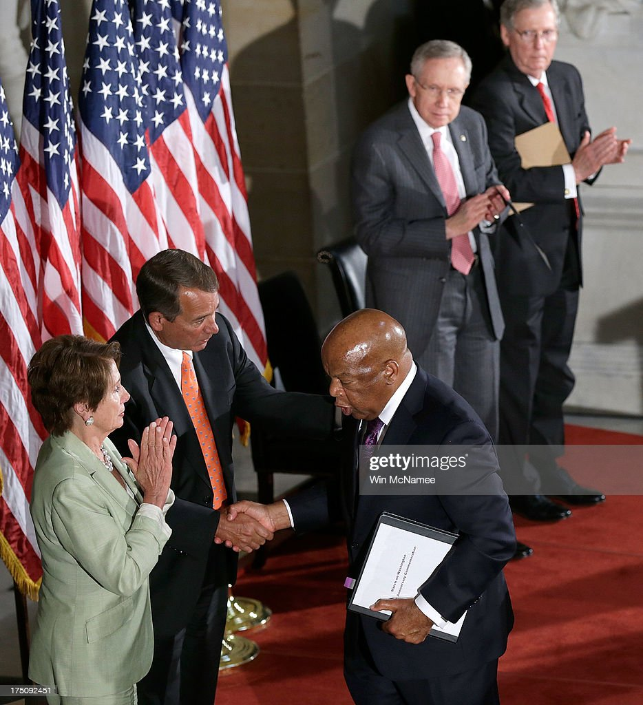 U.S. Rep. John Lewis (D-GA) (C) shakes hands with Speaker of the House <a gi-track='captionPersonalityLinkClicked' href=/galleries/search?phrase=John+Boehner&family=editorial&specificpeople=274752 ng-click='$event.stopPropagation()'>John Boehner</a> (R-OH) (C) and House Minority Leader <a gi-track='captionPersonalityLinkClicked' href=/galleries/search?phrase=Nancy+Pelosi&family=editorial&specificpeople=169883 ng-click='$event.stopPropagation()'>Nancy Pelosi</a> (D-CA) (L) as Senate Majority Leader Harry Reid (D-NV) (2nd R) and Senate Minority Leader Mitch McConnell (R-KY) look on in Statuary Hall of the U.S. Capitol during a ceremony honoring the 50th anniversary of the March on Washington July 31, 2013 in Washington, DC. Lewis was a speaker on the day of the historic civil rights movement's March on Washington in 1963.