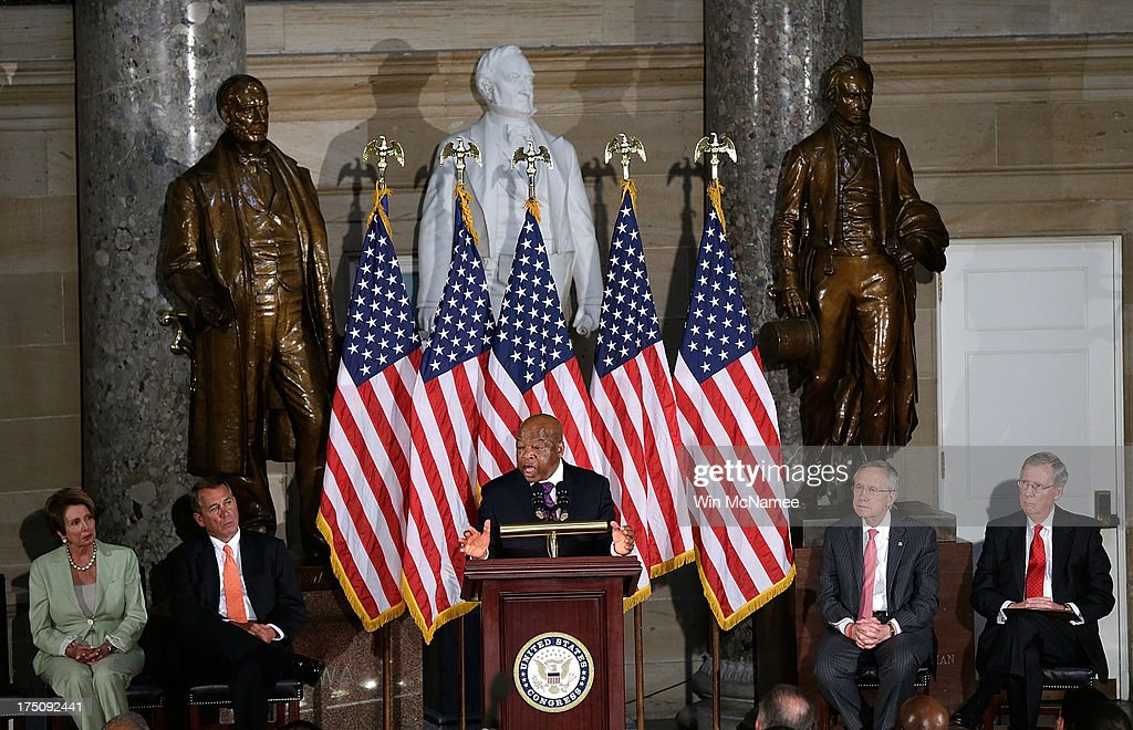S. Rep. John Lewis (C) speaks in Statuary Hall of the U.S. Capitol for a ceremony honoring the 50th anniversary of the March on Washington as House Minority Leader <a gi-track='captionPersonalityLinkClicked' href=/galleries/search?phrase=Nancy+Pelosi&family=editorial&specificpeople=169883 ng-click='$event.stopPropagation()'>Nancy Pelosi</a> (D-CA) (L), Speaker of the House John Boehner (R-OH) (2nd L), Senate Majority Leader Harry Reid (D-NV) (2nd R) and Senate Minority Leader Mitch McConnell (R-KY) look on July 31, 2013 in Washington, DC. Lewis was a speaker on the day of the historic civil rights movement's March on Washington in 1963.