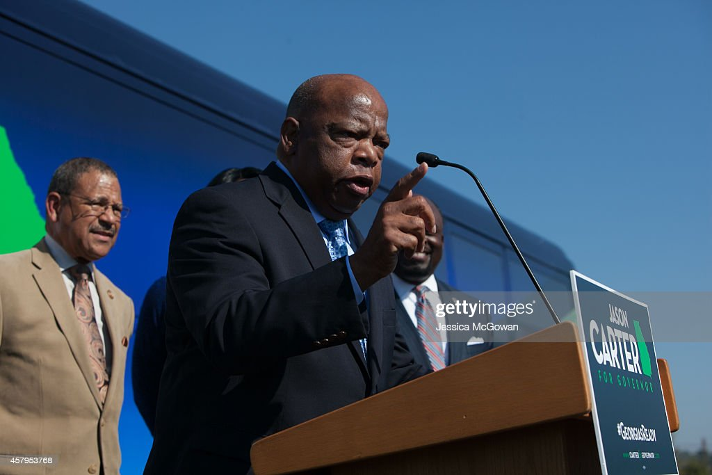 S Rep John Lewis speaks while campaigning for Georgia Democratic gubernatorial candidate and State Sen Jason Carter at Emmanuel Christian Community...