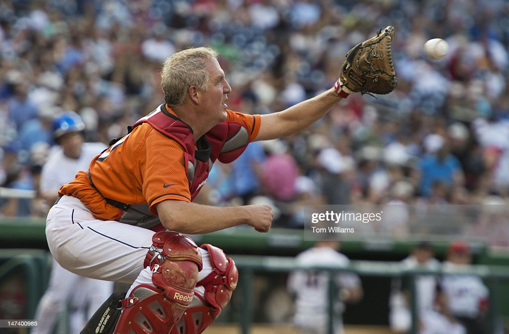 Rep. John Shimkus, R-Ill., catches a warm up pitch during the 51st Annual CQ Roll Call Congressional Baseball Game held at Nationals Park. The Democrats prevailed over the Republicans 18-5.