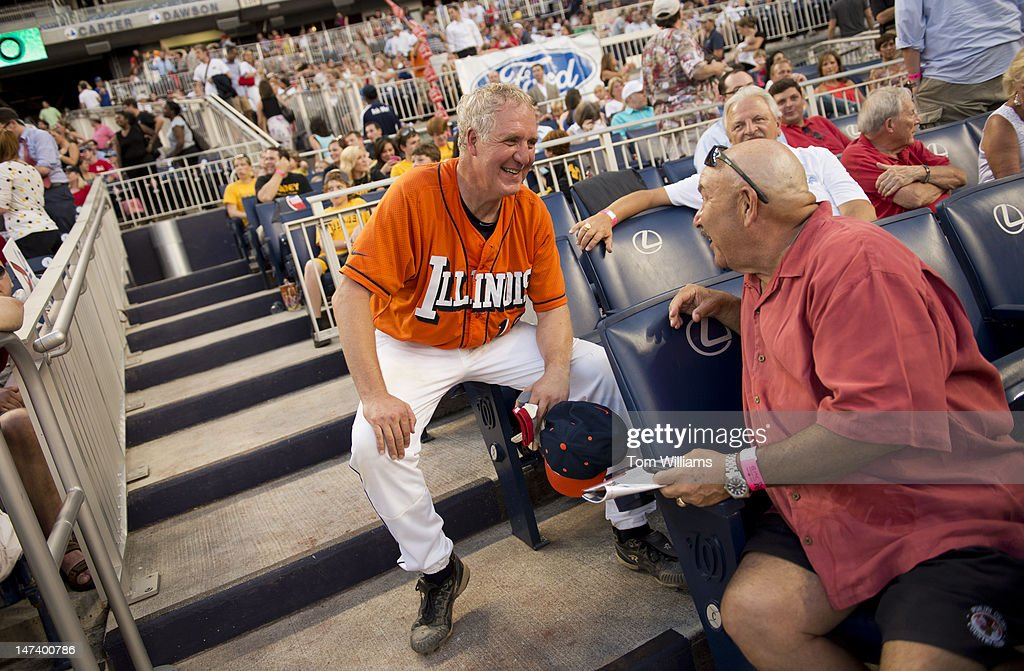 Rep. John Shimkus, R-Ill., left, talks with Al Clark, former MLB umpire, during the 51st Annual CQ Roll Call Congressional Baseball Game held at Nationals Park. The Democrats prevailed over the Republicans 18-5.