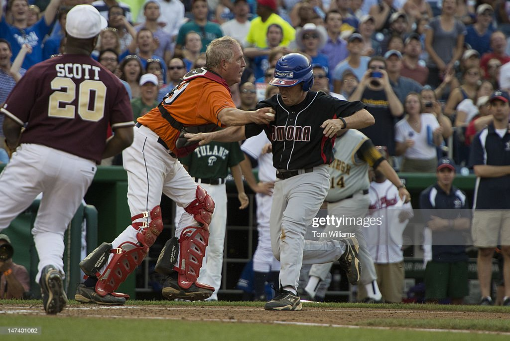 Rep. John Shimkus, R-Ill., tags Rep. Ed Perlmutter, D-Colo., out at home plate during the 51st Annual CQ Roll Call Congressional Baseball Game held at Nationals Park. The Democrats prevailed over the Republicans 18-5.
