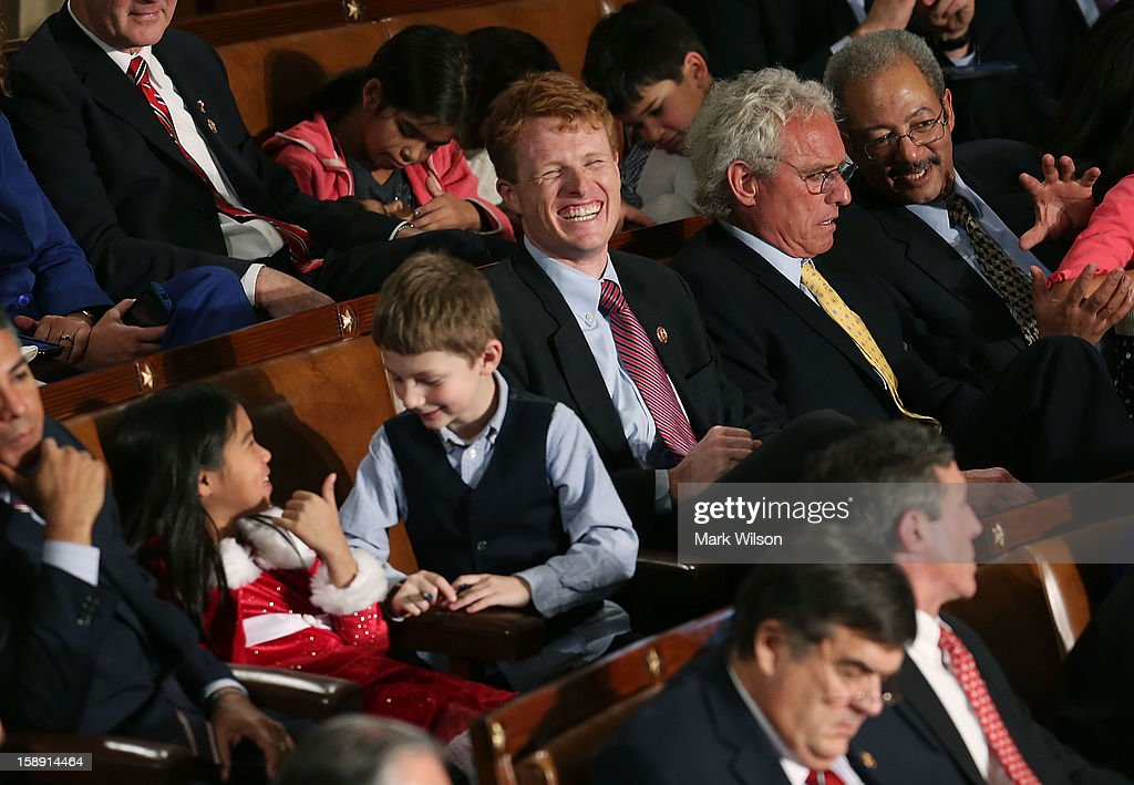 U.S. Rep. Joseph Kennedy (D-MA) (3rd R) sits with his father former Congressman Joseph Patrick Kennedy II (D-MA) (2nd R) during the first session of the 113th Congress in the House Chambers January 3, 2013 in Washington, DC. House Speaker Boehner was re-elected as Speaker and presided over the swearing in of the newly elected members of the 113th Congress.