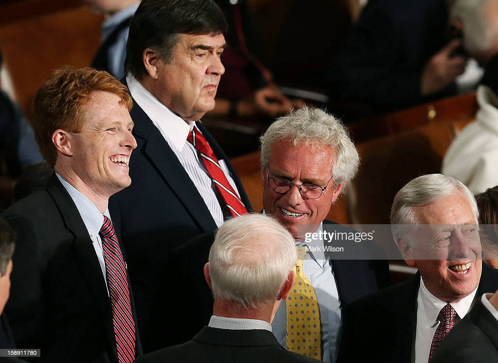 U.S. Rep. Joseph Kennedy (D-MA) (L), stands with his father former Congressman Joseph Patrick Kennedy II (D-MA) (3rd R), during the first session of the 113th Congress in the House Chambers January 3, 2013 in Washington, DC. House Speaker Boehner was re-elected as Speaker and presided over the swearing in of the newly elected members of the 113th Congress.
