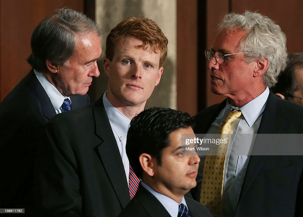 U.S. Rep. Joseph Kennedy (D-MA) (2nd L), stands with his father former Congressman Joseph Patrick Kennedy II (D-MA) (R), and U.S. Rep. Edward J. Markey (D-MA) (L) during the first session of the 113th Congress in the House Chambers January 3, 2013 in Washington, DC. House Speaker Boehner was re-elected as Speaker and presided over the swearing in of the newly elected members of the 113th Congress.