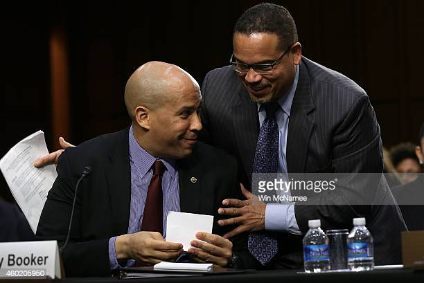 Rep Keith Ellison and Sen Cory Booker embrace after testifying before the Senate Judiciary Committee's Constitution Civil Rights and Human Rights...