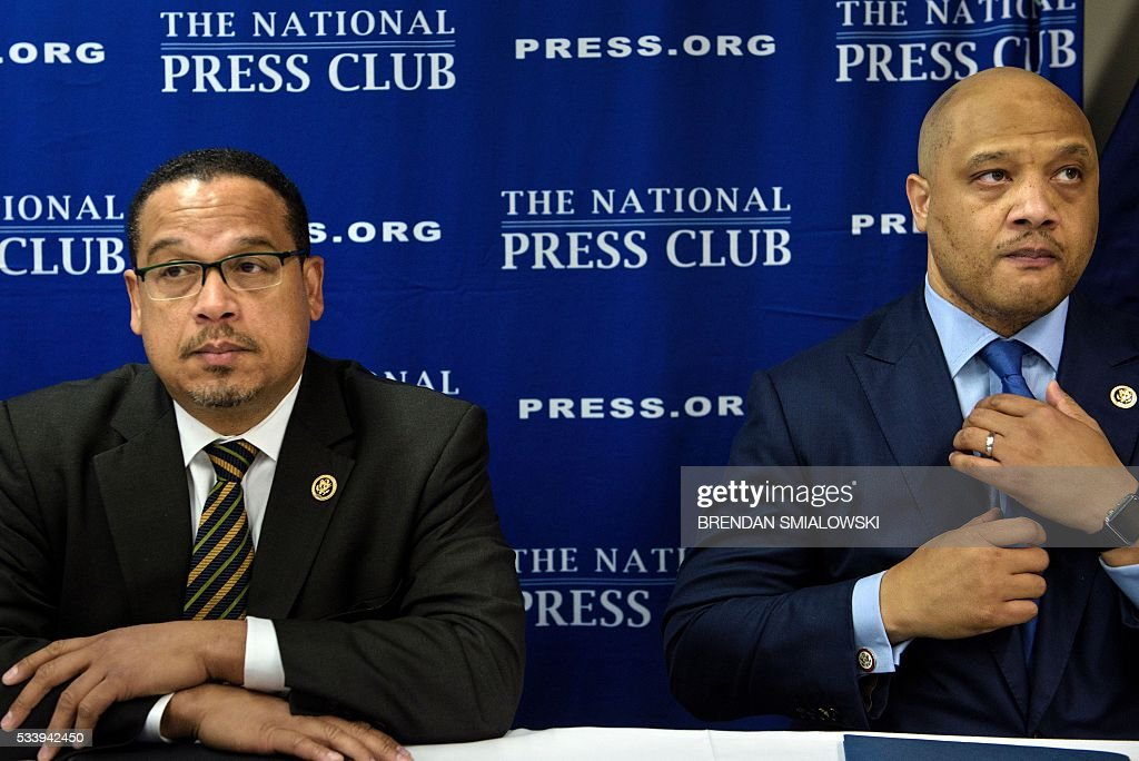 Rep. Keith Ellison(L) D-MN and Rep. Andre Carson (D-IN) wait to speak during a press conference about Islamophobia at the National Press Club May 24, 2016 in Washington, DC. / AFP / Brendan Smialowski