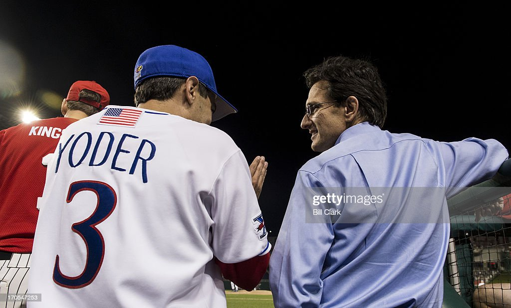 Rep. Kevin Yoder, R-Kan., speaks with House Majority Leader Eric Cantor, D-Va., in the dugout during the 52nd annual Congressional Baseball Game at national Stadium in Washington on Thursday, June 13, 2013.