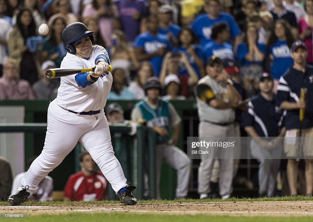 Rep. Linda Sanchez, D-Calif., bats during the 52nd annual Congressional Baseball Game at national Stadium in Washington on Thursday, June 13, 2013.