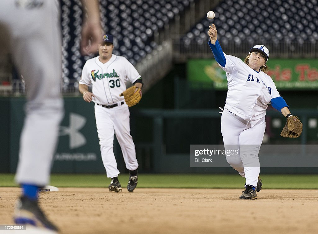 Rep. Linda Sanchez, D-Calif., fields a ground ball and throws to first base during the 52nd annual Congressional Baseball Game at national Stadium in Washington on Thursday, June 13, 2013.