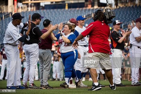 Rep Linda Sanchez DCalif gets highfives from his fellow Democrats during player introductions at the 54th Annual Roll Call Congressional Baseball...