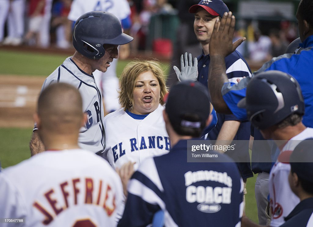 Rep. Linda Sanchez, D-Calif., returns to her dugout during the Congressional Baseball game where the Democrats beat the Republicans 22-0 at Nationals Park.