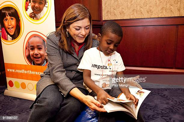 Rep Loretta Sanchez reads to a child at Jump Start's 'Read for the Record' at Capitol Hill on October 8 2009 in Washington DC