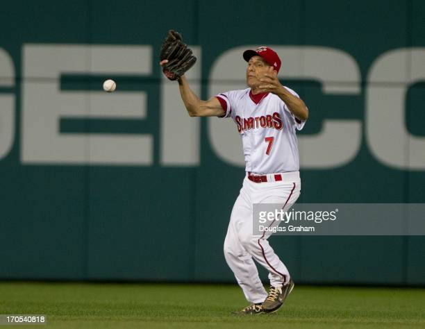 Rep Lou Barletta handles a fly ball to left field during the 52nd annual Congressional Baseball Game at National Stadium in Washington on Thursday...