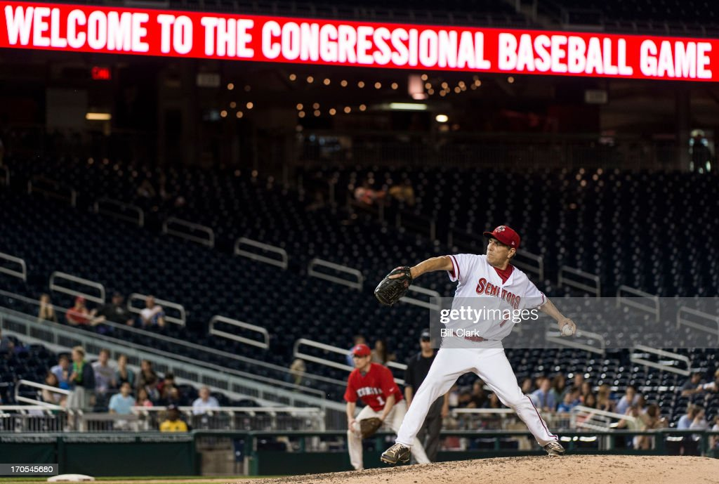Rep. Lou Barletta, R-Pa., pitches during the 52nd annual Congressional Baseball Game at national Stadium in Washington on Thursday, June 13, 2013.