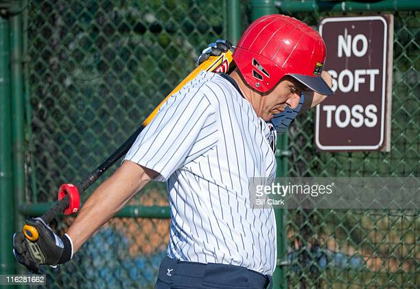 Rep Lou Barletta RPa waits for his turn in the batting cage during the Republicans' baseball practice at Four Mile Run Park in Alexandria Va on...