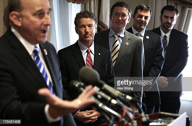 US Rep Louie Gohmert speaks as Sen Rand Paul Rep Thomas Massie and Rep Justin Amash listens during a news conference June 13 2013 at the Capitol Hill...