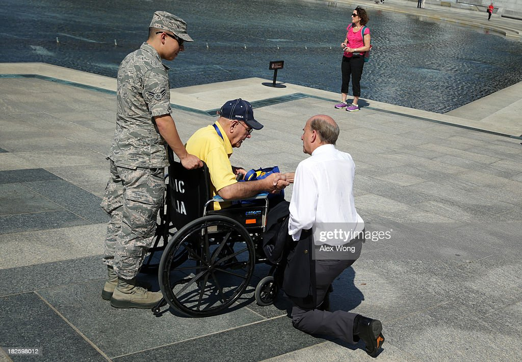 U.S. Rep. Louie Gohmert (R-TX) (R) talks to a military veteran at the World War II Memorial during a government shutdown October 1, 2013 in Washington, DC. The memorial was temporary opened to veteran groups arrived on Honor Flights on a day trip to visit the nation's capital.