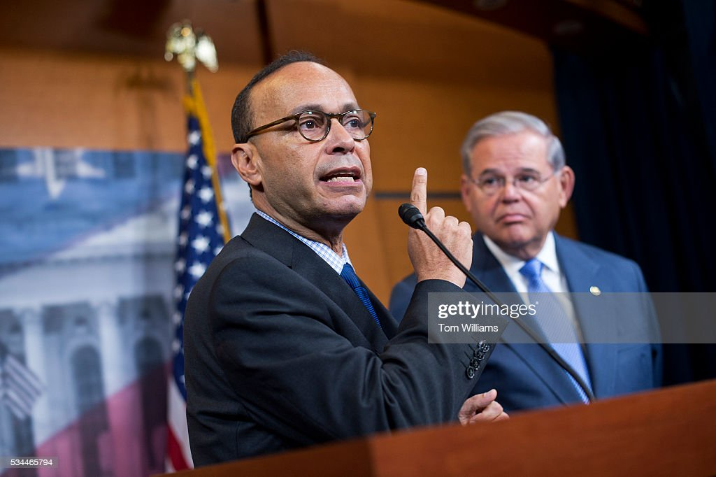 Rep. Luis Gutierrez, D-Ill., left, and Sen. Bob Menendez, D-N.J., conduct news conference in the Capitol Visitor Center on the Puerto Rico Oversight, Management, and Economic Stability Act, which is meant to alleviate the country's debt, May 26, 2016.