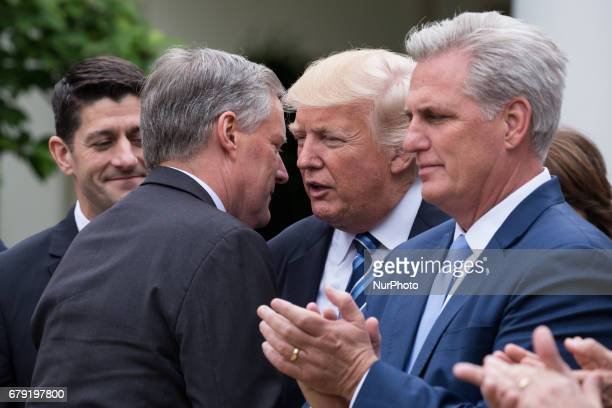 Rep Mark Meadows and chair of the Freedom Caucus shakes hands with President Trump at the press conference with members of the GOP on the passage of...