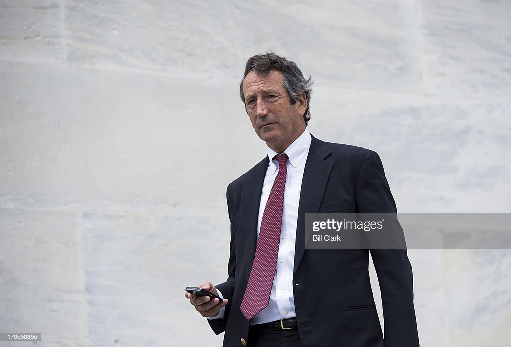 Rep. Mark Sanford, R-S.C., walks down the House steps of the Capitol following the last votes of the week on Friday, June 14, 2013.