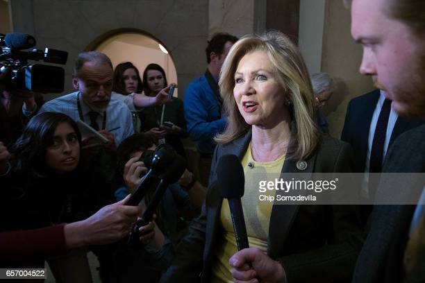 Rep Marsha Blackburn is surrounded by reporters after leaving the office of Speaker of the House Paul Ryan at the US Capitol March 23 2017 in...