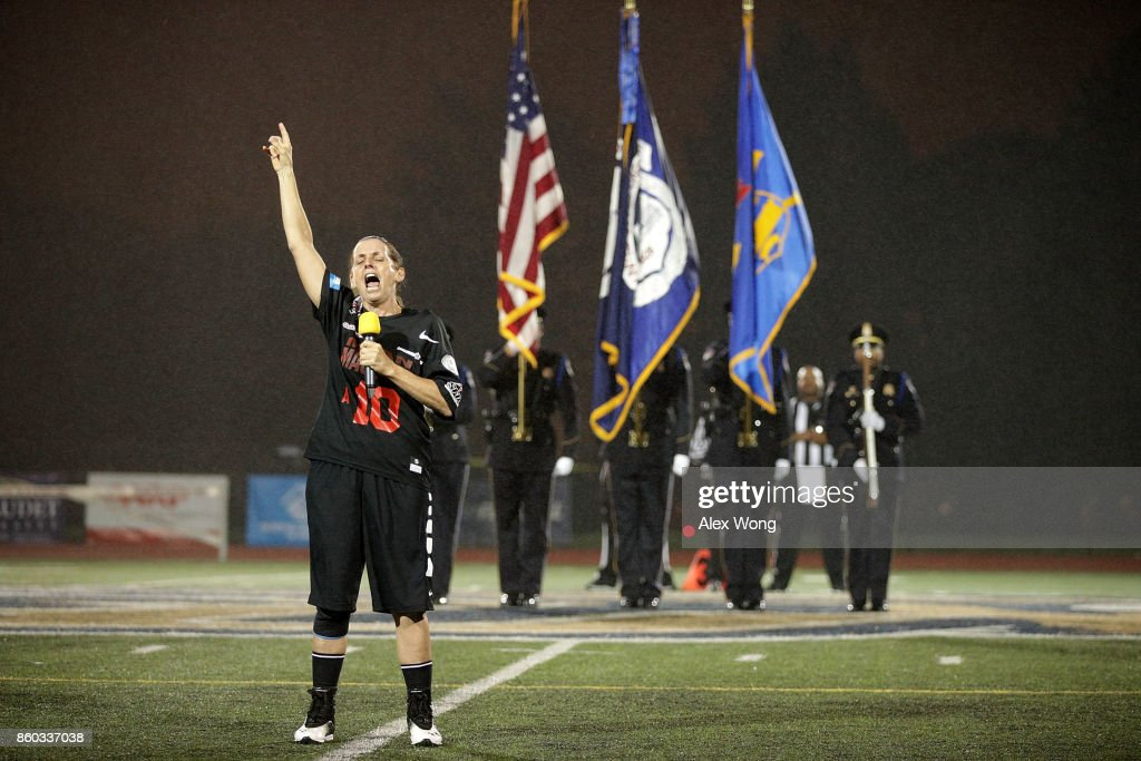 U.S. Rep. Martha McSally (R-AZ) sings the national anthem during pregame of 2017 Congressional Football Game October 11, 2017 at Gallaudet University in Washington, DC. Members of Congress and former NFL players team up against the U.S. Capitol Police for the biennial Congressional Football Game, which began in 2005 following the loss of Capitol Police officers John Gibson and Jacob Chestnut in the line of duty in 1998, to raise money to benefit the families of fallen police officers.