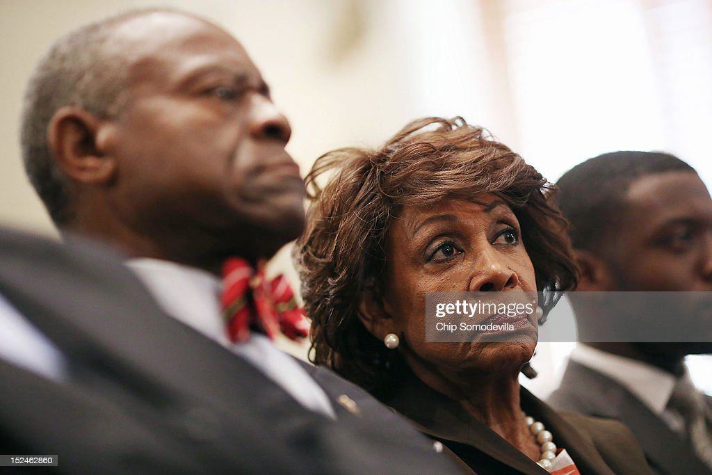 Rep. <a gi-track='captionPersonalityLinkClicked' href=/galleries/search?phrase=Maxine+Waters&family=editorial&specificpeople=220525 ng-click='$event.stopPropagation()'>Maxine Waters</a> (D-CA) (2nd R) and her husband Sidney Williams (L) listen to opening statements during a rare open House Committee on Ethics hearing in the Longworth House Office Building on Capitol Hill September 21, 2012 in Washington, DC. A long-running investigation found that Waters did not commit an ethics violaiton when her office in late 2008 set up a meeting with top Treasury Department officials on behalf of a bank Williams owned stock in, at a time when the bank faced possible collapse because of the financial crisis. However, Waters' Chief of Staff and grandson, Mikael Moore, was issued a letter of reproval for three ethics violations for helping the bank.