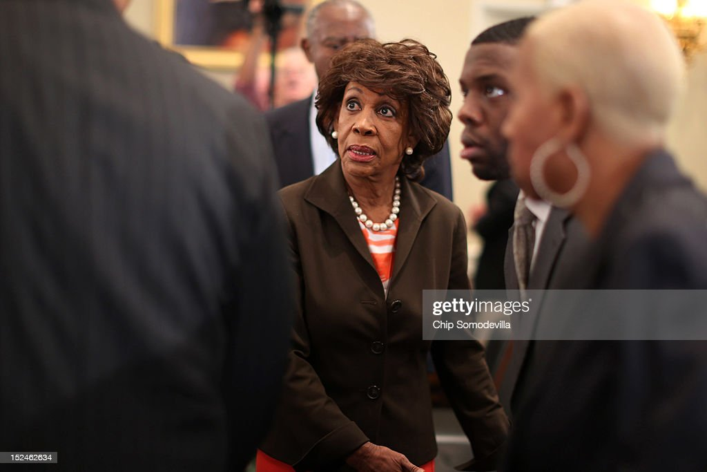 Rep. Maxine Waters (D-CA) (C) arrives for a rare open House Committee on Ethics hearing in the Longworth House Office Building on Capitol Hill September 21, 2012 in Washington, DC. A long-running investigation found that Waters did not commit an ethics violaiton when her office in late 2008 set up a meeting with top Treasury Department officials on behalf of a bank Williams owned stock in, at a time when the bank faced possible collapse because of the financial crisis. However, Waters' Chief of Staff and grandson, Mikael Moore, was issued a letter of reproval for three ethics violations for helping the bank.