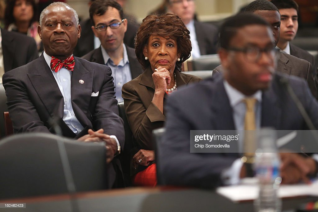 Rep. <a gi-track='captionPersonalityLinkClicked' href=/galleries/search?phrase=Maxine+Waters&family=editorial&specificpeople=220525 ng-click='$event.stopPropagation()'>Maxine Waters</a> (D-CA) (C), her husband Sidney Williams (L) and her grandson and Chief of Staff Mikael Moore (R) listen to opening statements during a rare open House Committee on Ethics hearing in the Longworth House Office Building on Capitol Hill September 21, 2012 in Washington, DC. A long-running investigation found that Waters did not commit an ethics violaiton when her office in late 2008 set up a meeting with top Treasury Department officials on behalf of a bank Williams owned stock in, at a time when the bank faced possible collapse because of the financial crisis. However, Moore was issued a letter of reproval for three ethics violations for helping the bank.
