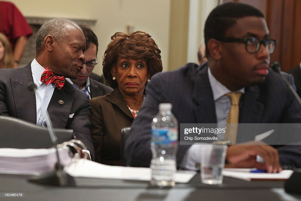 Rep. Maxine Waters (D-CA) (C), her husband Sidney Williams (L) and her grandson and Chief of Staff Mikael Moore (R) listen to opening statements during a rare open House Committee on Ethics hearing in the Longworth House Office Building on Capitol Hill September 21, 2012 in Washington, DC. A long-running investigation found that Waters did not commit an ethics violaiton when her office in late 2008 set up a meeting with top Treasury Department officials on behalf of a bank Williams owned stock in, at a time when the bank faced possible collapse because of the financial crisis. However, Moore was issued a letter of reproval for three ethics violations for helping the bank.