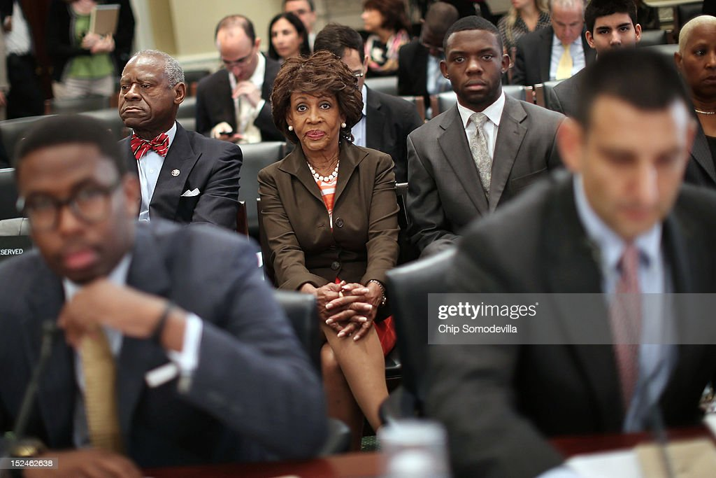 Rep. Maxine Waters (D-CA) (C), her husband Sidney Williams (2nd L) and her grandson and Chief of Staff Mikael Moore (L) listen to opening statements during a rare open House Committee on Ethics hearing in the Longworth House Office Building on Capitol Hill September 21, 2012 in Washington, DC. A long-running investigation found that Waters did not commit an ethics violaiton when her office in late 2008 set up a meeting with top Treasury Department officials on behalf of a bank Williams owned stock in, at a time when the bank faced possible collapse because of the financial crisis. However, Moore was issued a letter of reproval for three ethics violations for helping the bank.