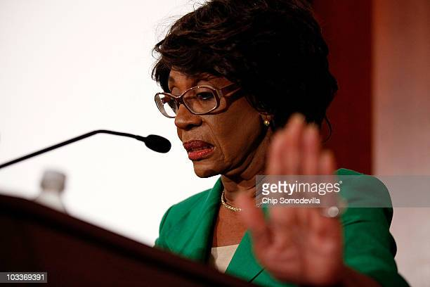 Rep Maxine Waters holds up her hand in an attempt to stop photographers from taking her picture during a news conference she called to challenge the...