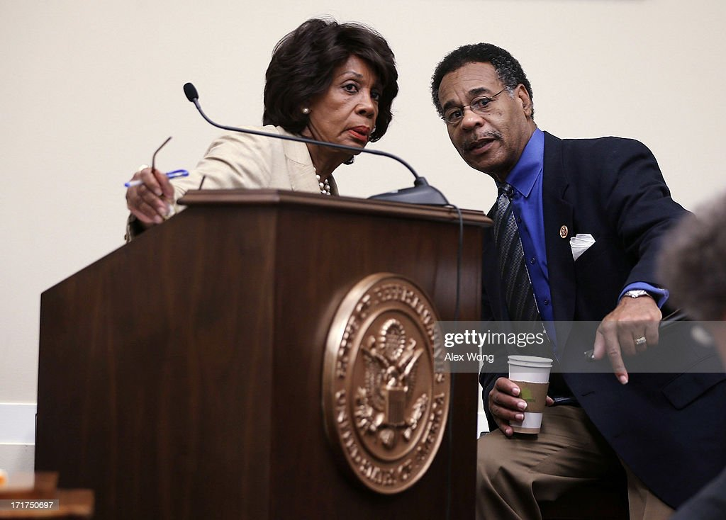 U.S. Rep. Maxine Waters (D-CA) (L) listens to Rep. Emanuel Cleaver (D-MO) (R) during a discussion June 28, 2013 on Capitol Hill in Washington, DC. Rep. Waters held the discussion on 'A Way Forward For Housing Finance Reform: Finding Sustainable Solutions to Ensure Access, Affordability, and Taxpayer Protection Part II.'