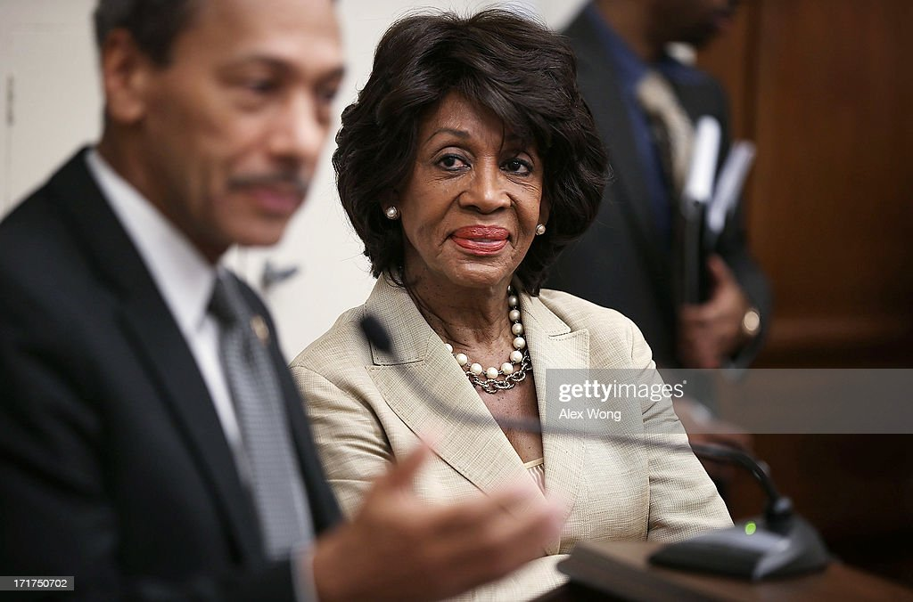 S Rep Maxine Waters listens to Rep Melvin Watt during a discussion June 28 2013 on Capitol Hill in Washington DC Rep Waters held the discussion on 'A...