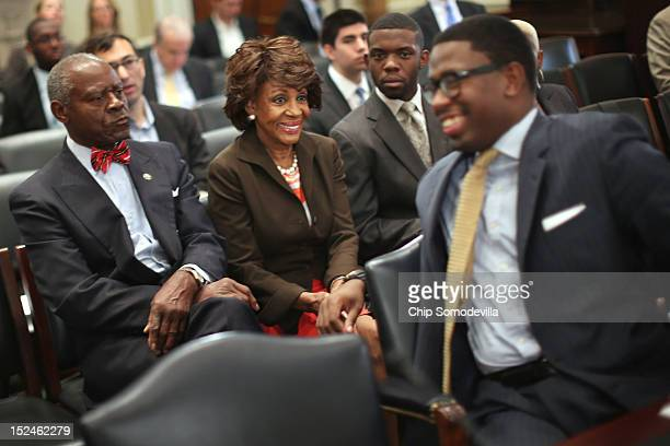 Rep Maxine Waters shares a laugh with her grandson and Chief of Staff Mikael Moore before the start of a rare open House Committee on Ethics hearing...
