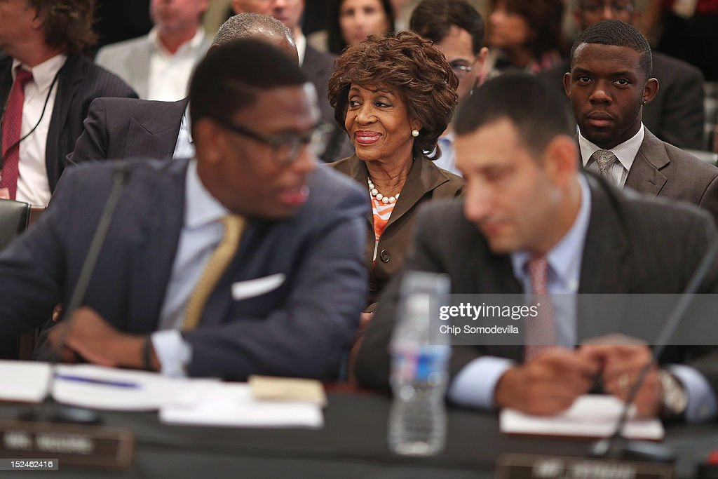 Rep. Maxine Waters (D-CA) (C) smiles before the start of a rare open House Committee on Ethics hearing in the Longworth House Office Building on Capitol Hill September 21, 2012 in Washington, DC. A long-running investigation found that Waters did not commit an ethics violaiton when her office in late 2008 set up a meeting with top Treasury Department officials on behalf of a bank Williams owned stock in, at a time when the bank faced possible collapse because of the financial crisis. However, Waters' Chief of Staff and grandson, Mikael Moore, was issued a letter of reproval for three ethics violations for helping the bank.