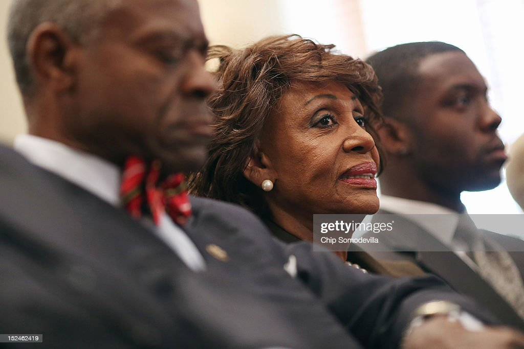 Rep. Maxine Waters (D-CA) (C) smiles during a rare open House Committee on Ethics hearing in the Longworth House Office Building on Capitol Hill September 21, 2012 in Washington, DC. A long-running investigation found that Waters did not commit an ethics violaiton when her office in late 2008 set up a meeting with top Treasury Department officials on behalf of a bank Williams owned stock in, at a time when the bank faced possible collapse because of the financial crisis. However, Waters' Chief of Staff and grandson, Mikael Moore, was issued a letter of reproval for three ethics violations for helping the bank.